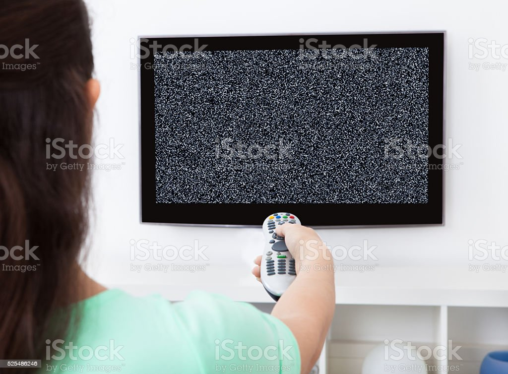 Woman In Front Of Television With No Signal stock photo