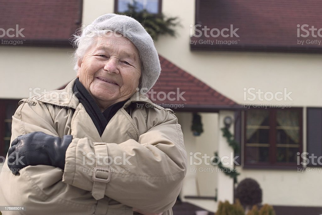 woman in front of the house. royalty-free stock photo