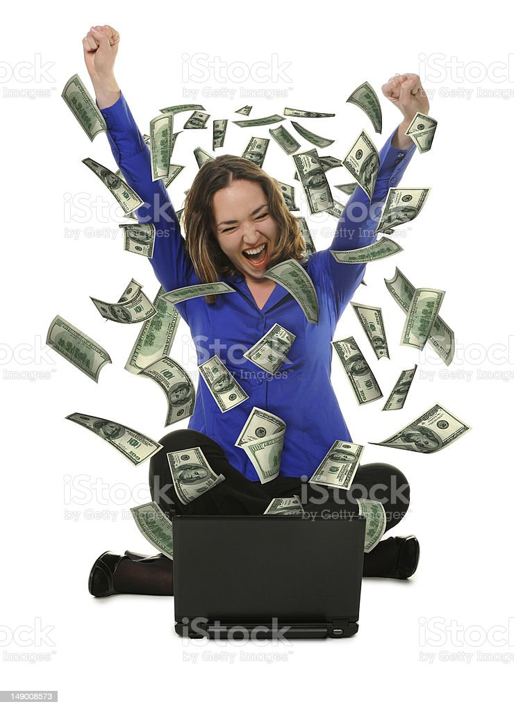 woman in front of the laptop with fly out dollars royalty-free stock photo