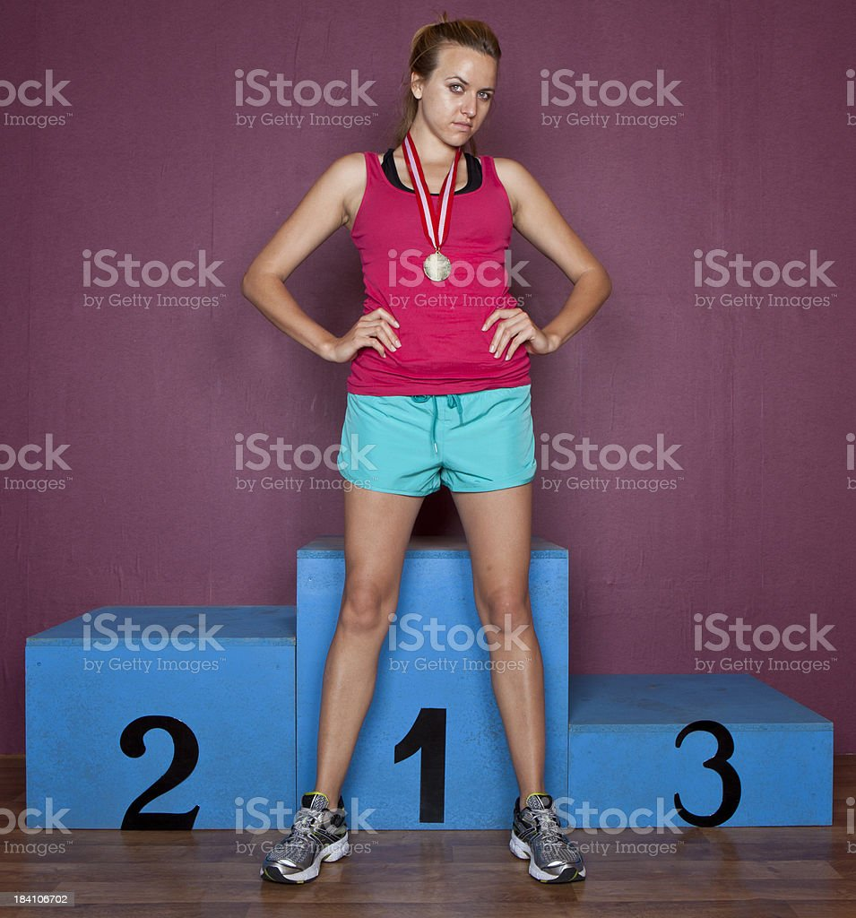 Woman in front on the winner's podium stock photo