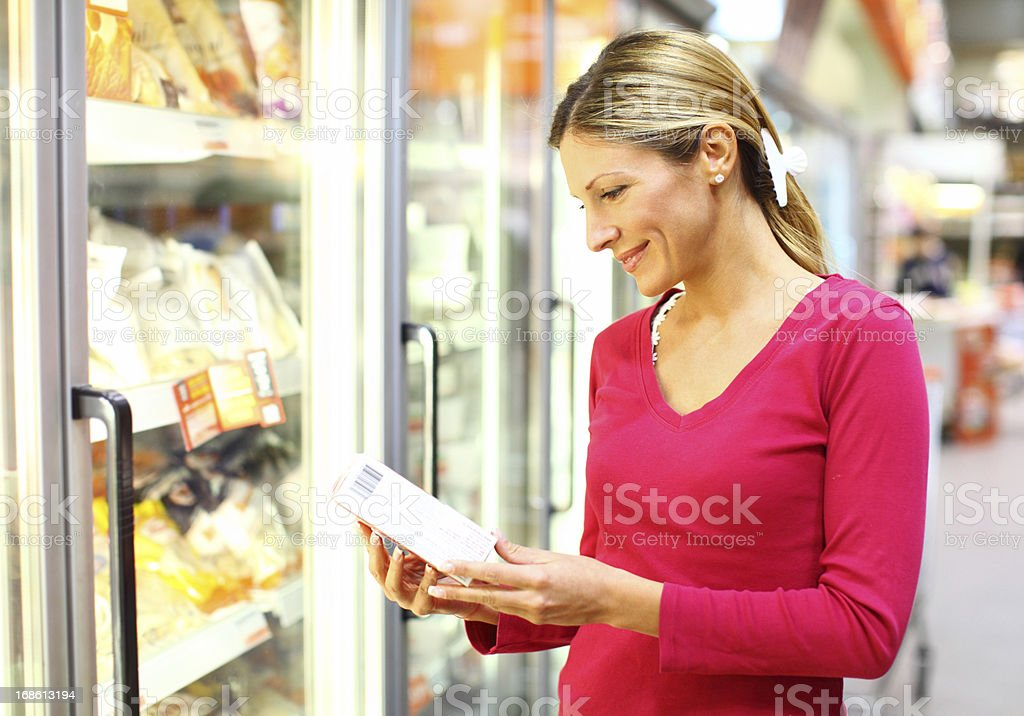 Woman in frozen-food section of supermarket stock photo