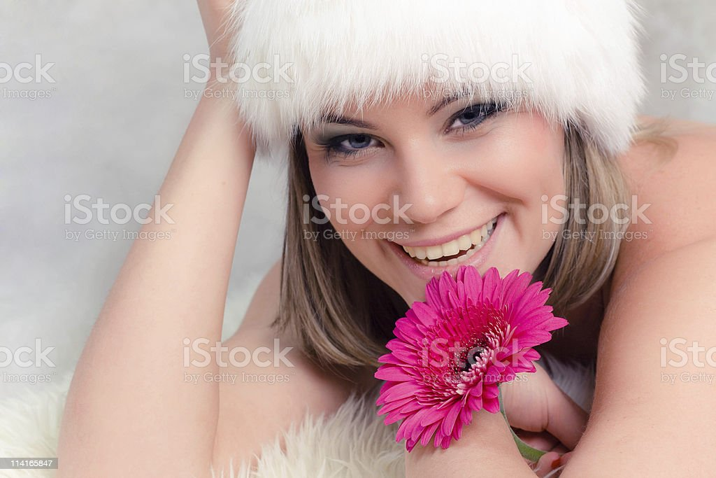 woman in fur hat with flower royalty-free stock photo