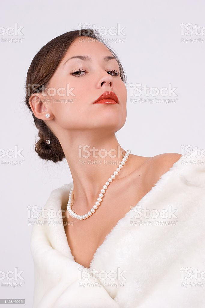 Woman in fur with pearls royalty-free stock photo