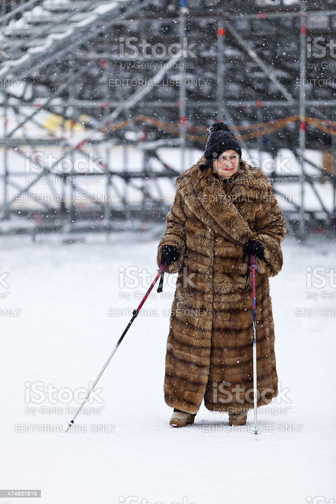Woman in Furcoat in front of Spectator Stands royalty-free stock photo