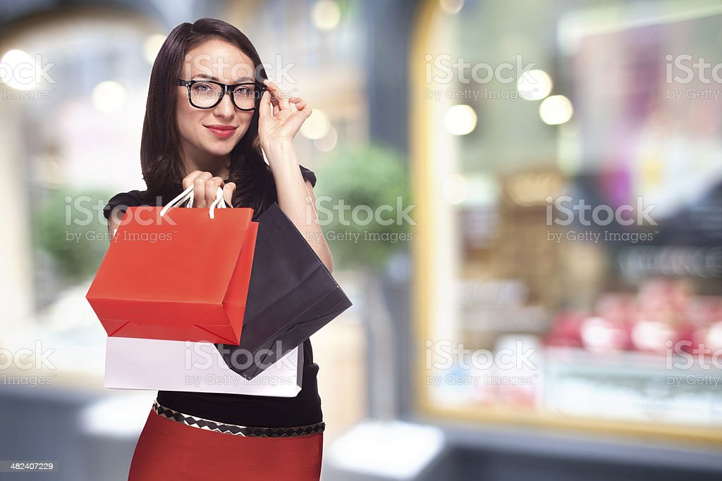 Woman in glasses shopping stock photo