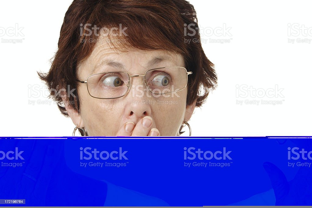 Woman in glasses with scared expression looking to her left stock photo