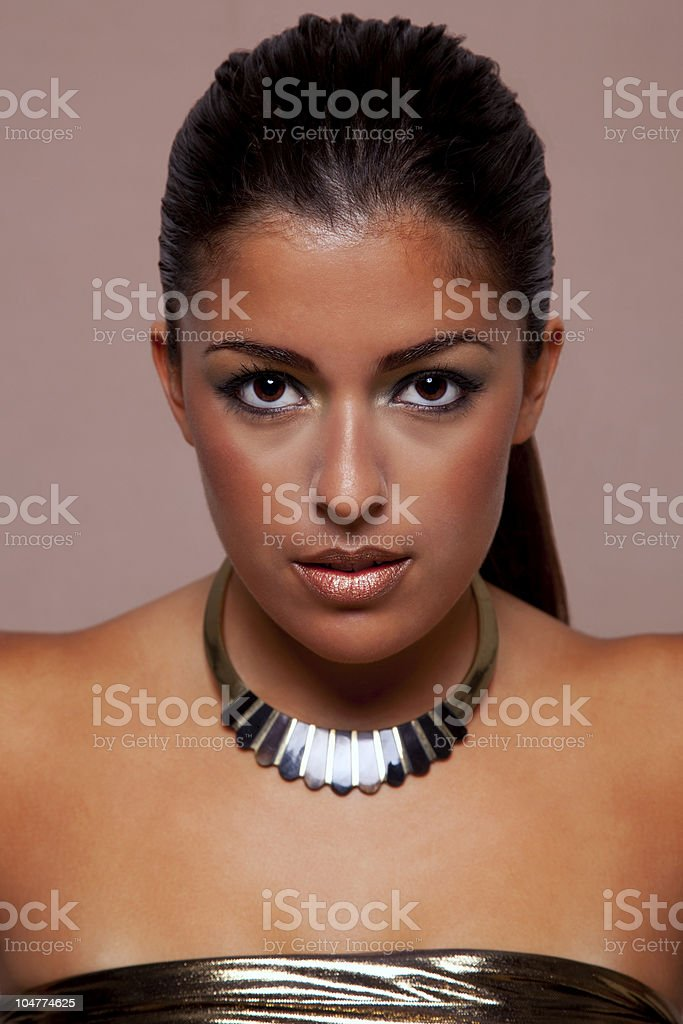 Woman in gold royalty-free stock photo