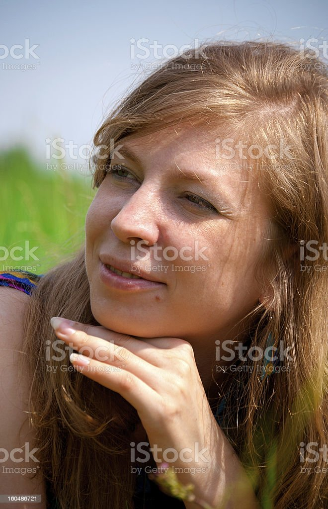 Woman in grass royalty-free stock photo