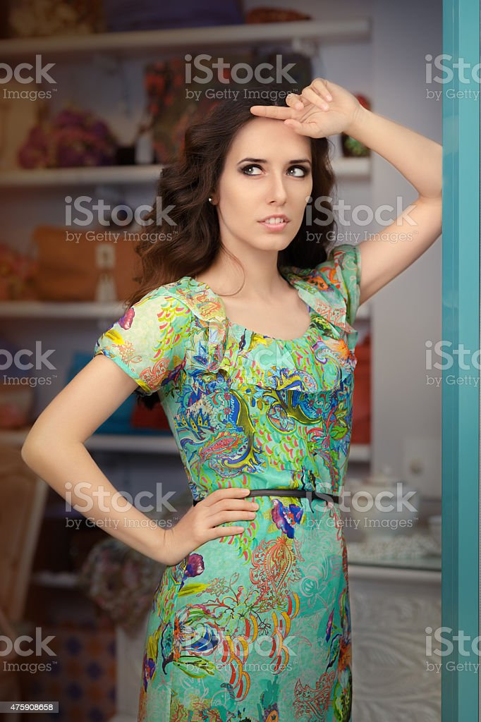 Woman in Green Floral Dress in Fashion Store stock photo