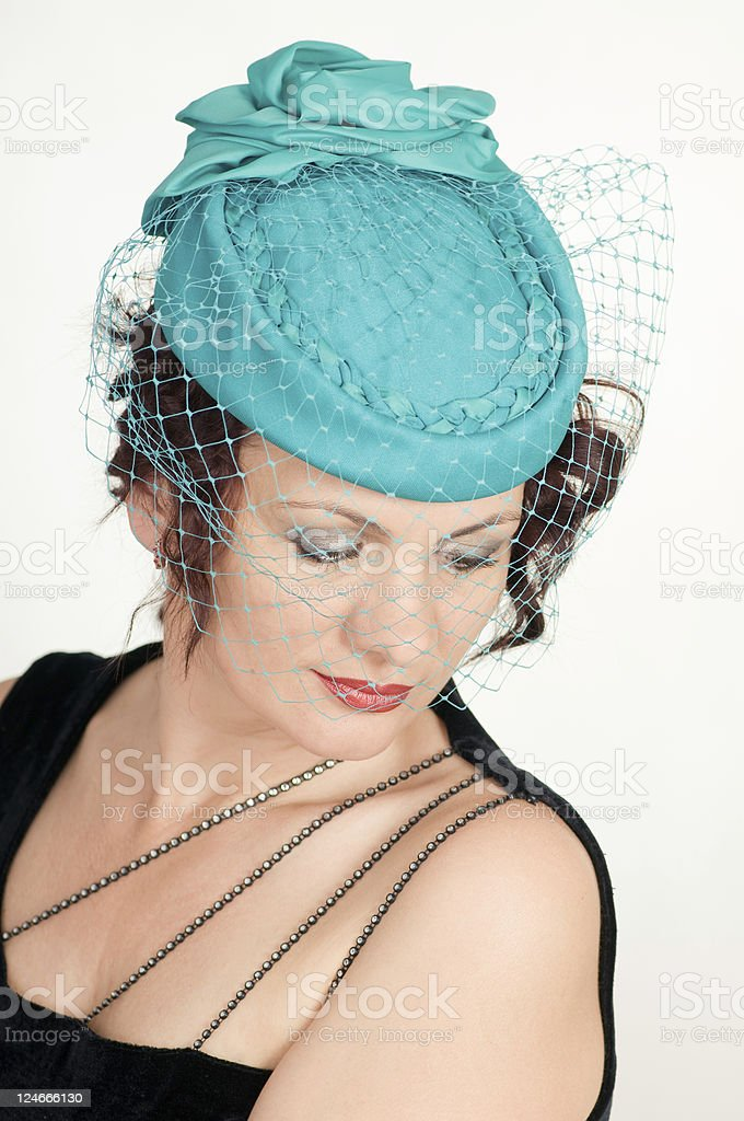 woman in green hat stock photo