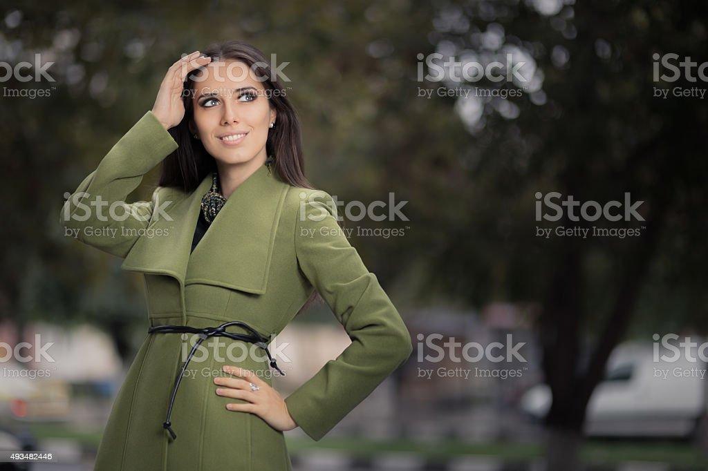 Woman in Green Jacket Outside stock photo