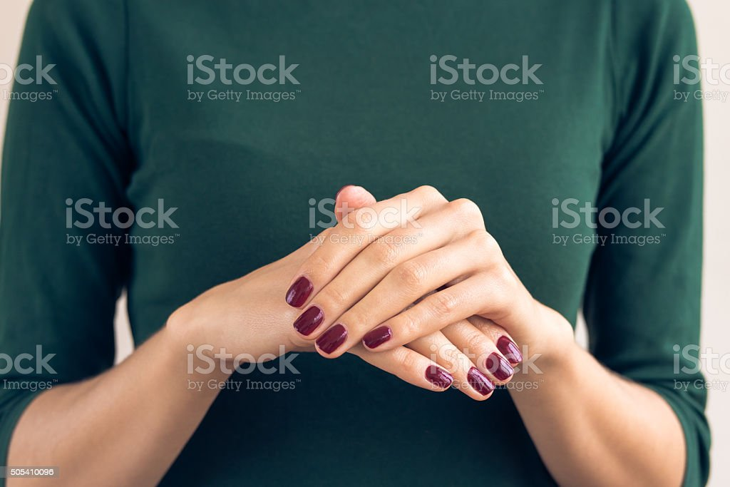 Woman in green T-shirt shows a hands stock photo