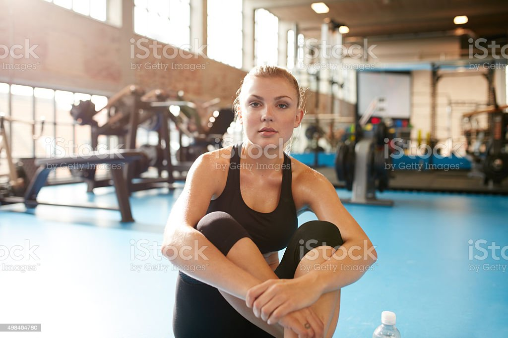 Woman in gym taking a break from workout stock photo