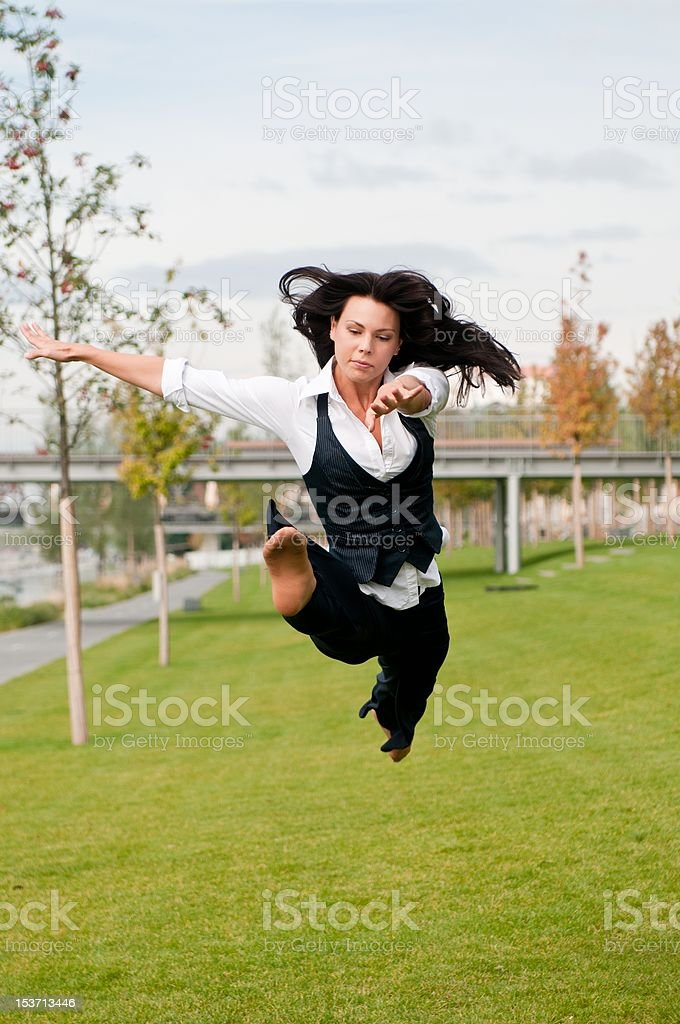 Woman in gymnastics jump outdoors royalty-free stock photo