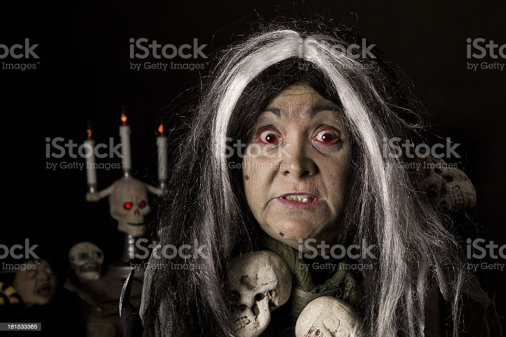 Woman in Halloween witch costume stock photo