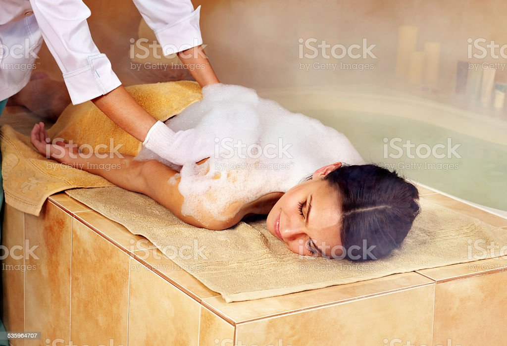 Woman in hammam or turkish bath stock photo