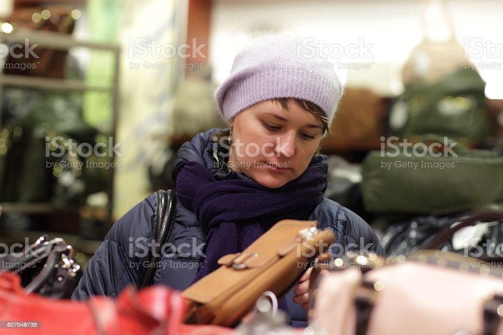 Woman in handbags store stock photo