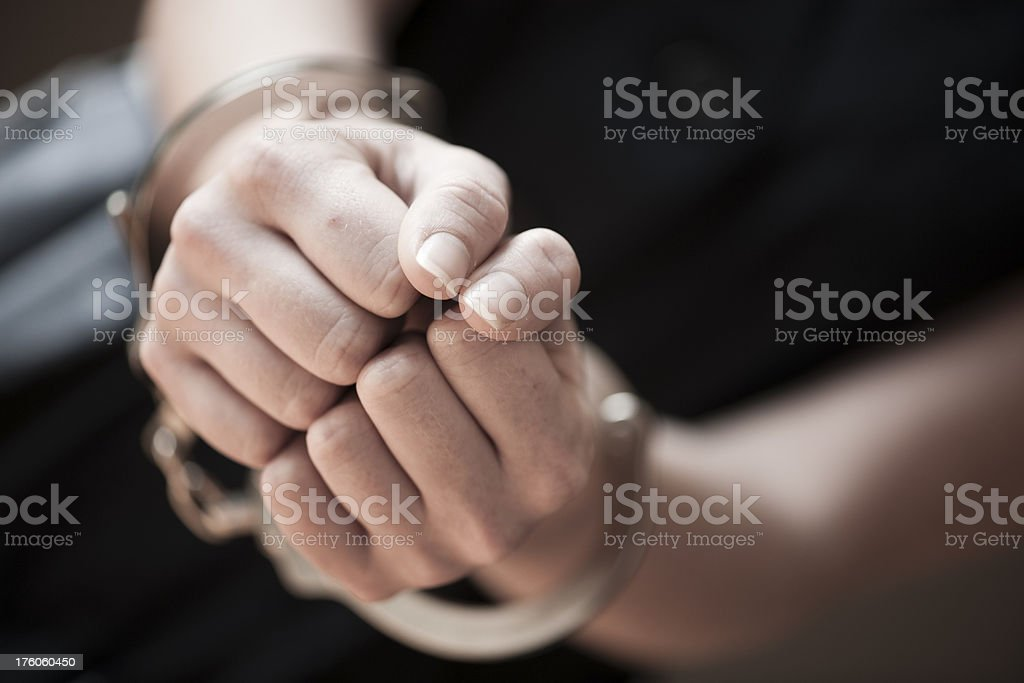 Woman in handcuffs stock photo