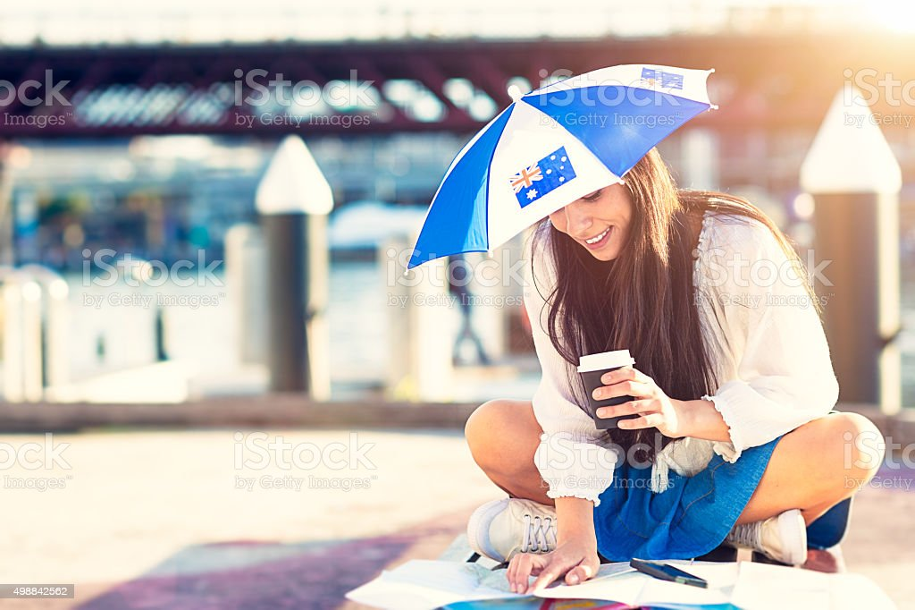 Woman in  hat at shape of umbrella with Australian flag stock photo