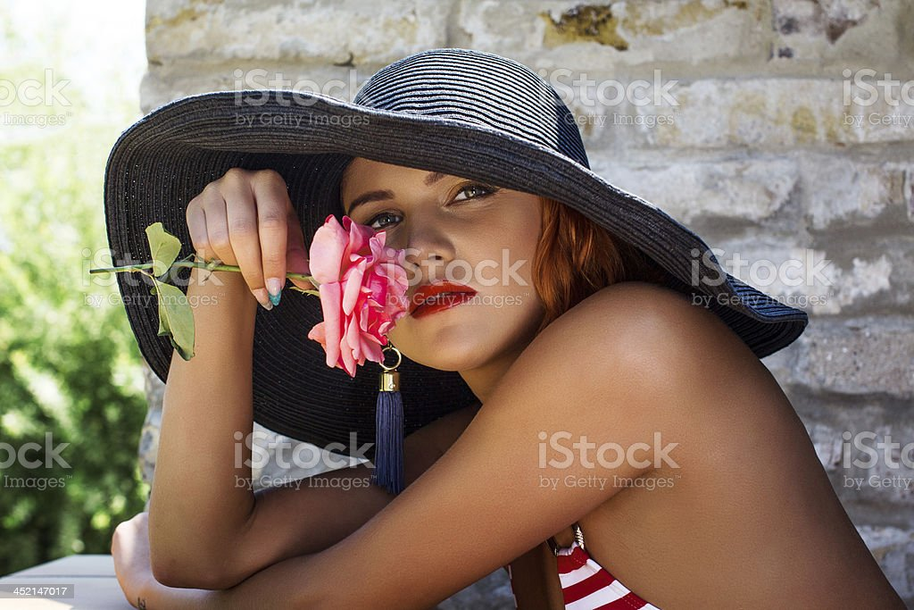 Woman in hat smell flower royalty-free stock photo