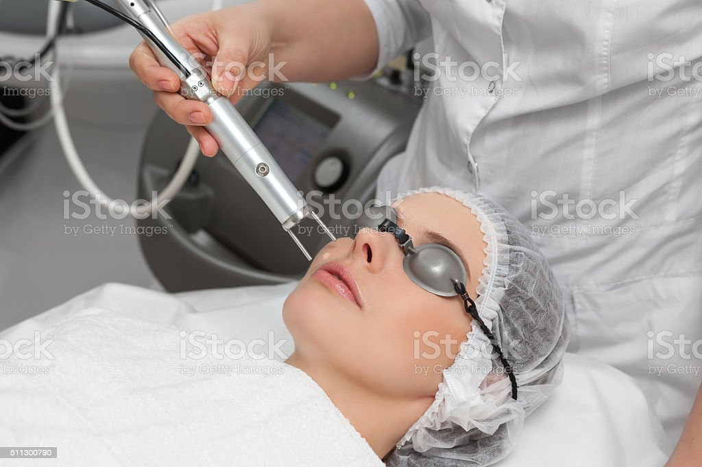 Woman in healthy beauty spa salon stock photo