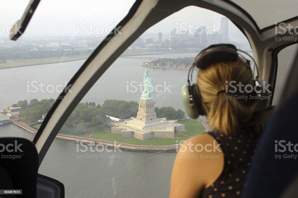 Woman in helicopter ride over new York stock photo