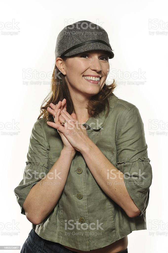 Woman in her 30s wearing a cap royalty-free stock photo