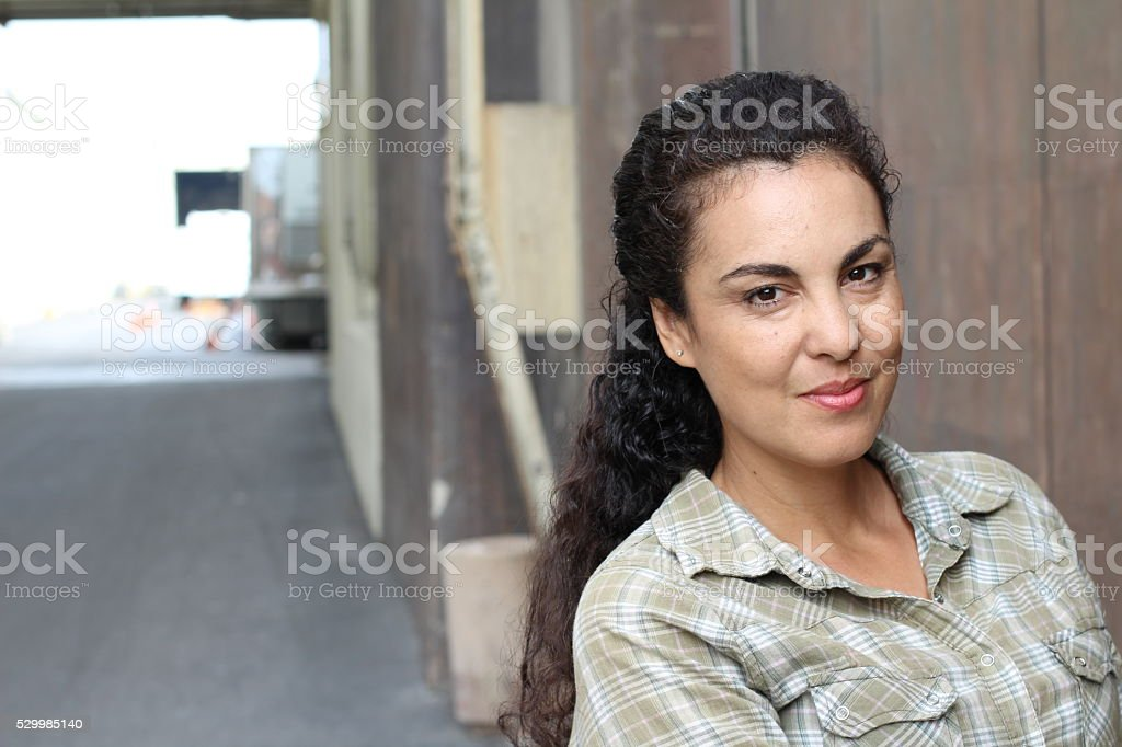 woman in her forties in urban background stock photo
