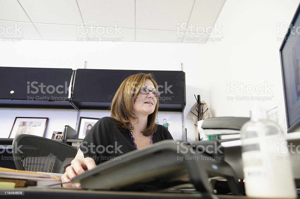 Woman in her office stock photo