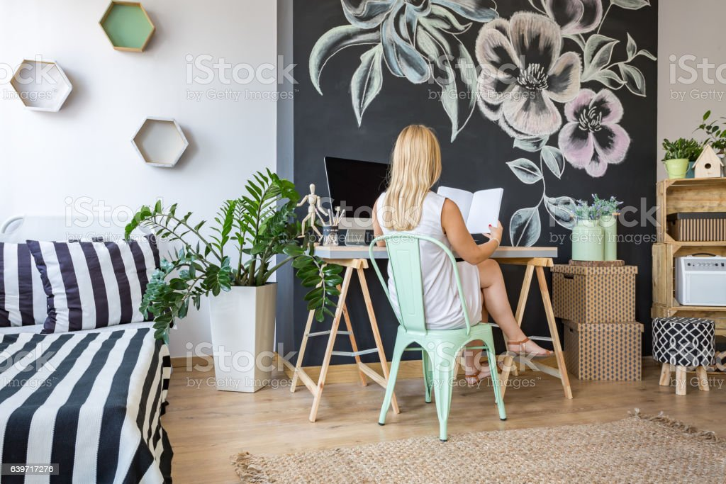 Woman in her study space stock photo