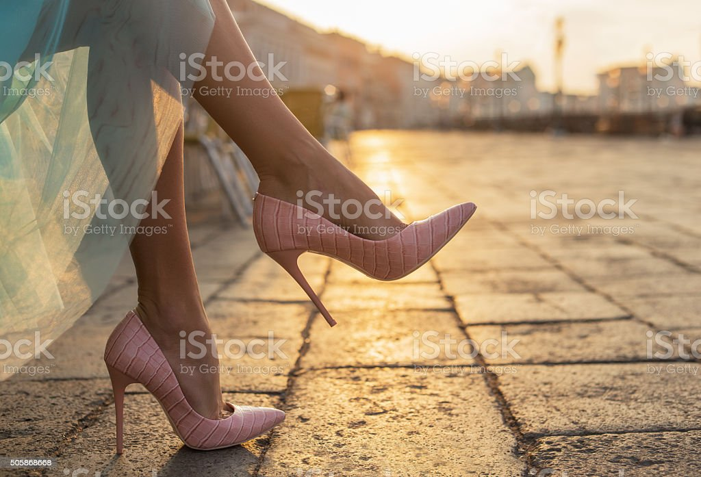 Woman in high heel shoes in city by sunrise  Image ID:289040633 stock photo