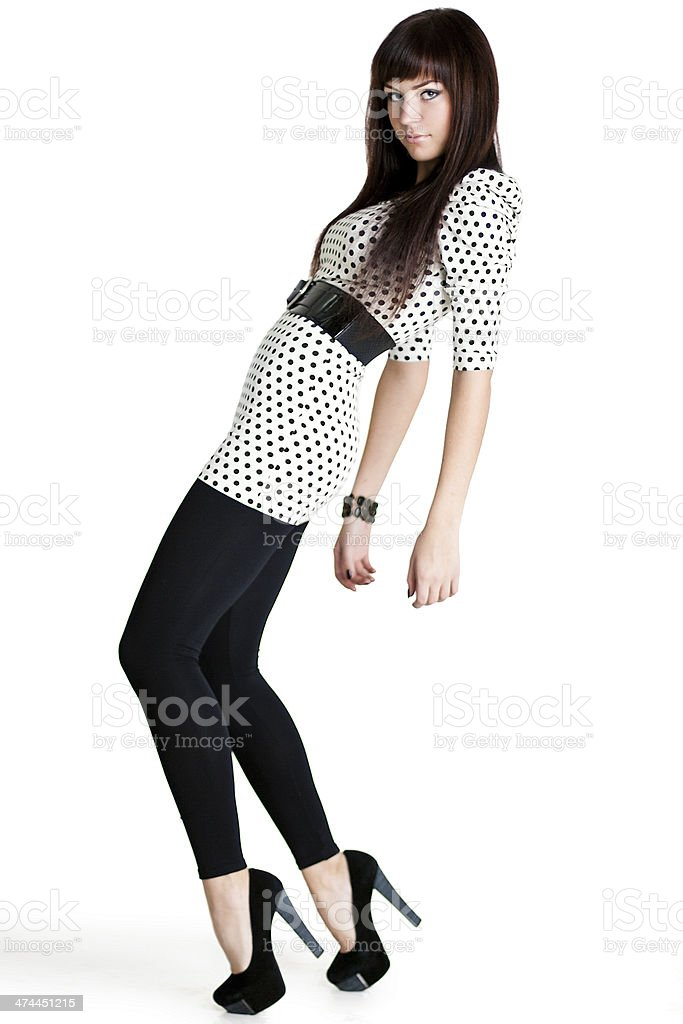 Woman in high-heeled shoes standing on tiptoes stock photo