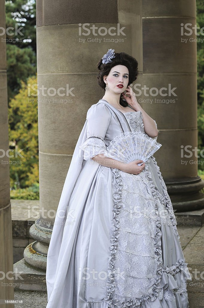 Woman in Historical Rococo Costume Portrait with Fan royalty-free stock photo