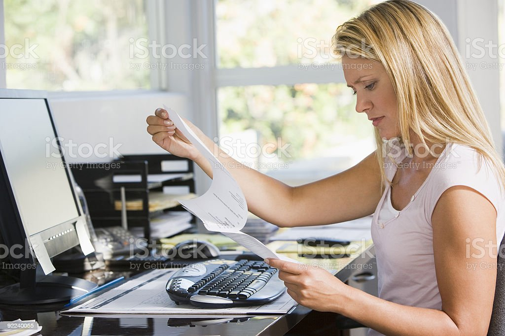 Woman in home office stock photo