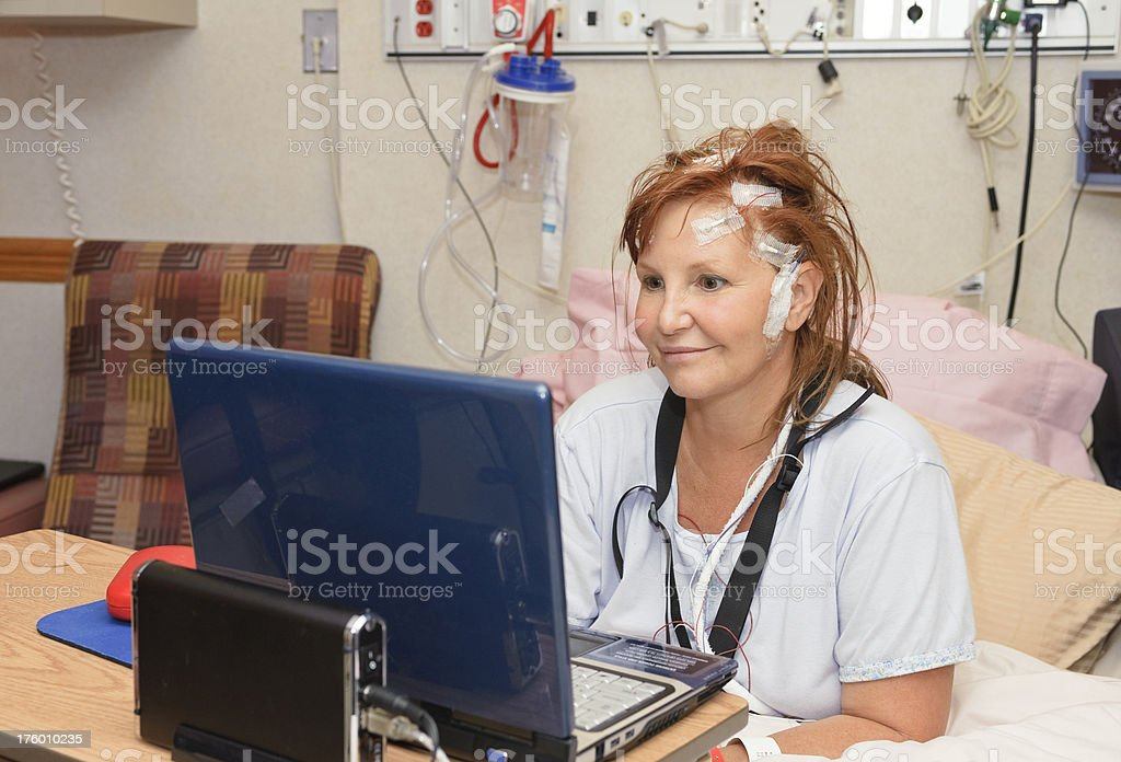 Woman in Hospital Bed with Laptop royalty-free stock photo