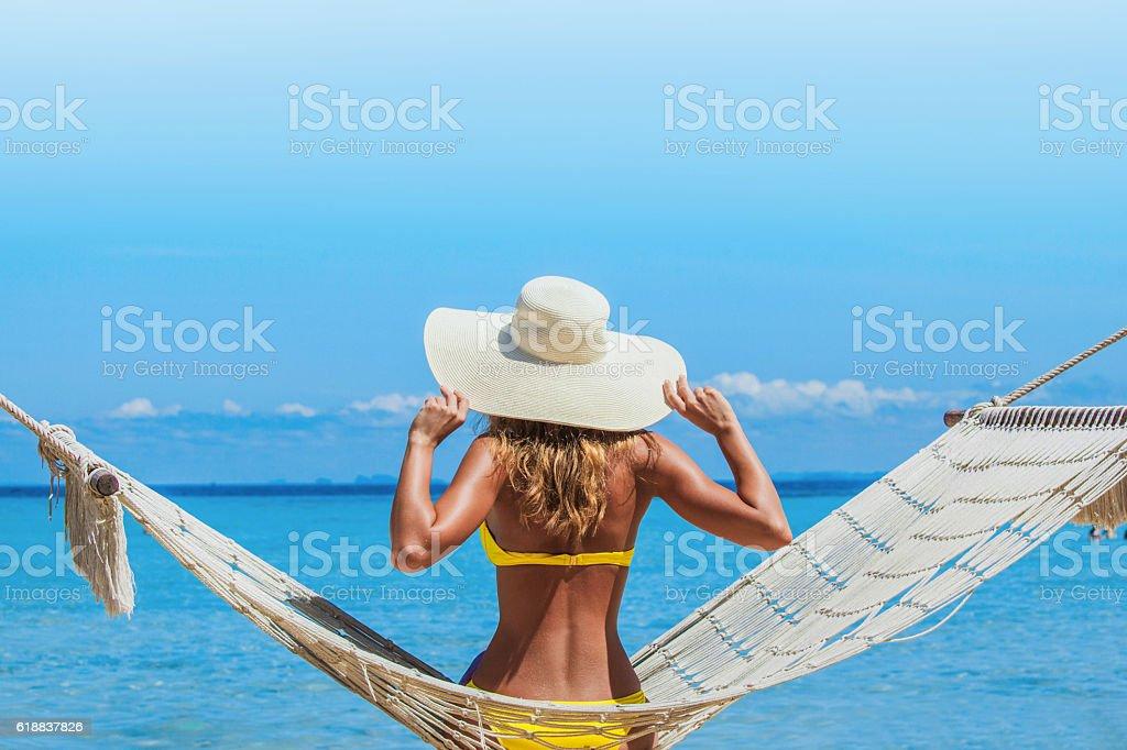 Woman in hummock stock photo