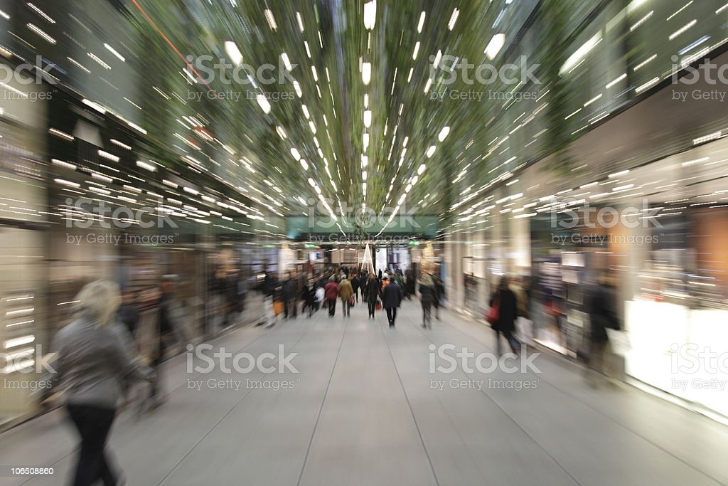 woman in hurry motion blurred at mall munich downtown XXXL royalty-free stock photo