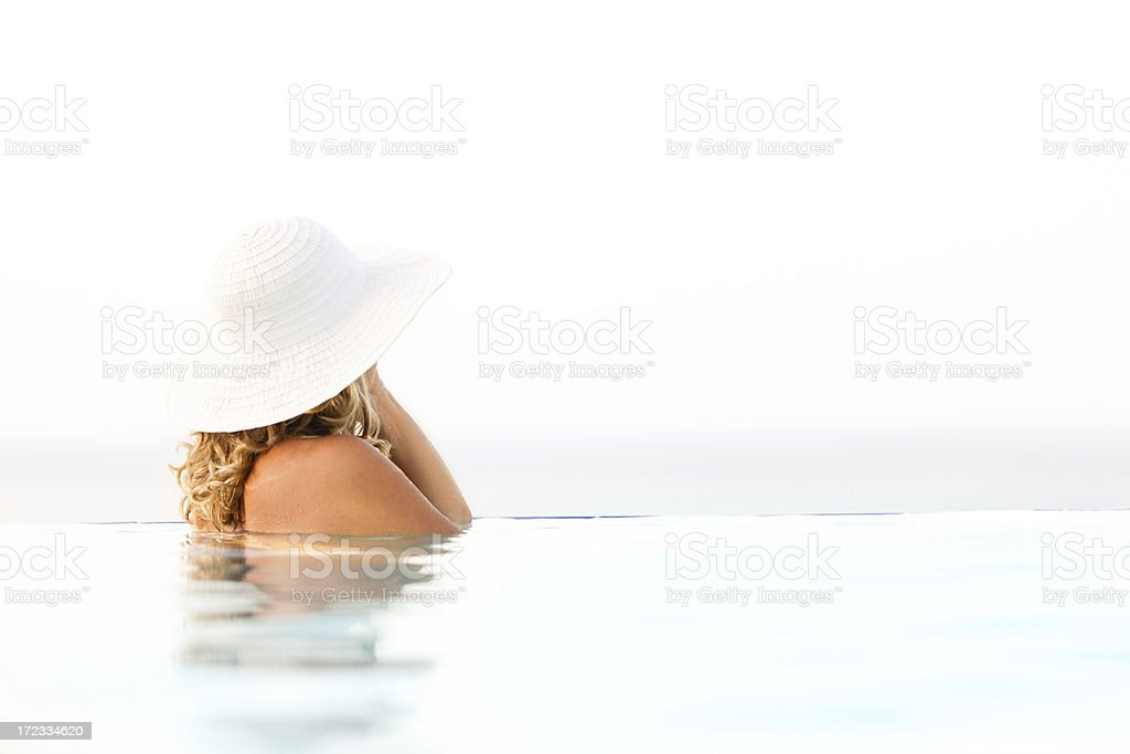 Woman in infinity pool royalty-free stock photo
