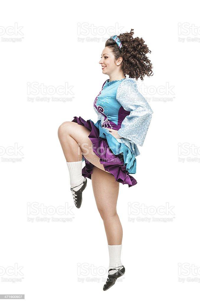 Woman in irish dance dress dancing isolated stock photo