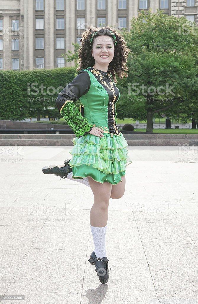 Woman in irish dance dress dancing stock photo