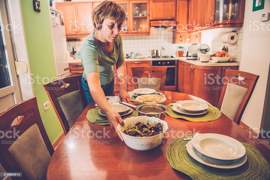 Woman in Jeans Adding Putting Radicchio on the Table, Europe stock photo