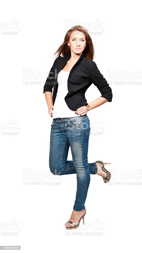 Woman in jeans and a black blazer wearing heels royalty-free stock photo