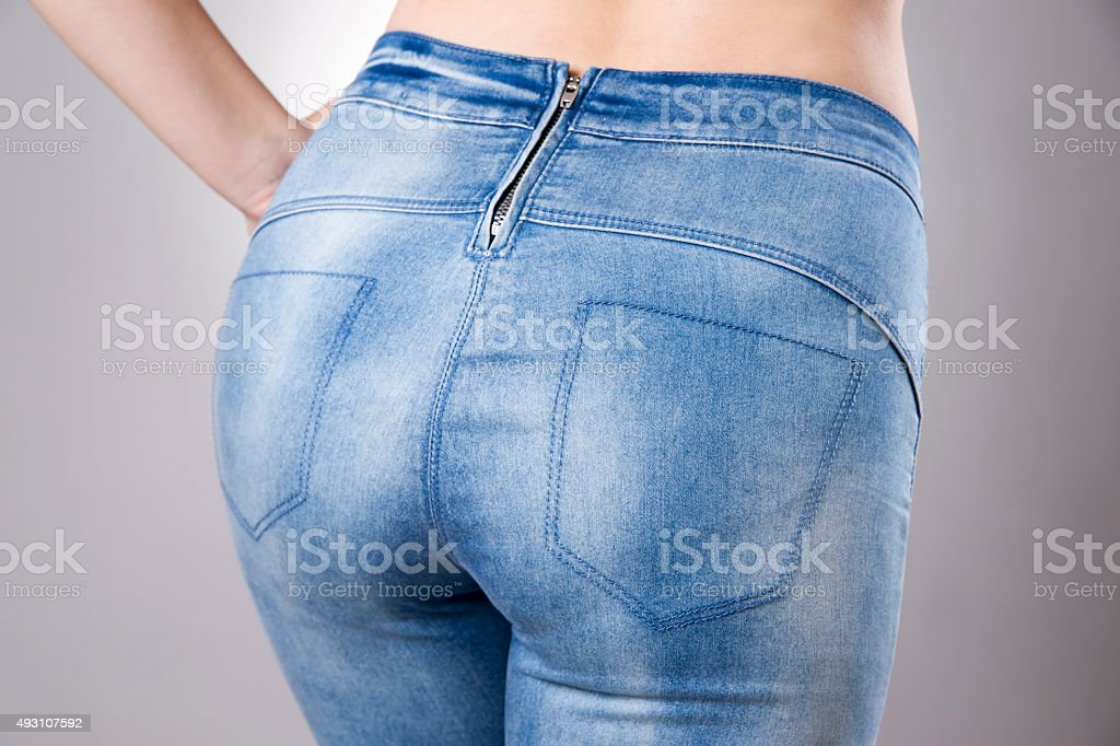 Woman in jeans close up. Beautiful female hips and buttocks stock photo
