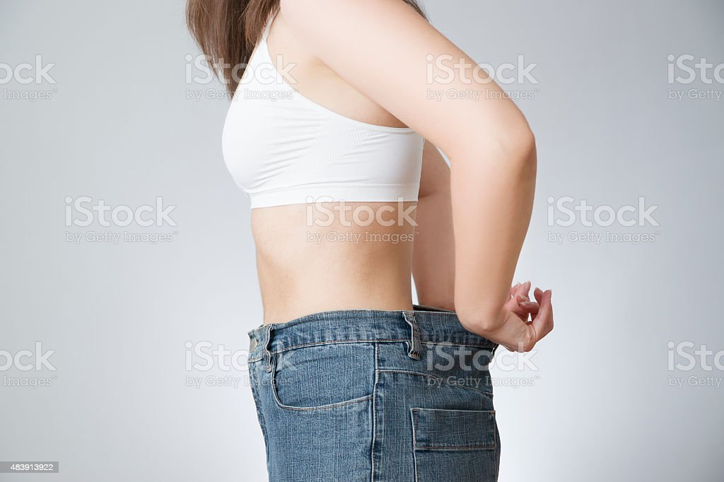 Woman in jeans of large size, concept of weight loss stock photo