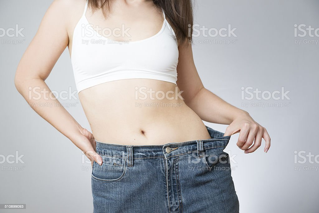 Woman in jeans of large size, concept weight loss stock photo