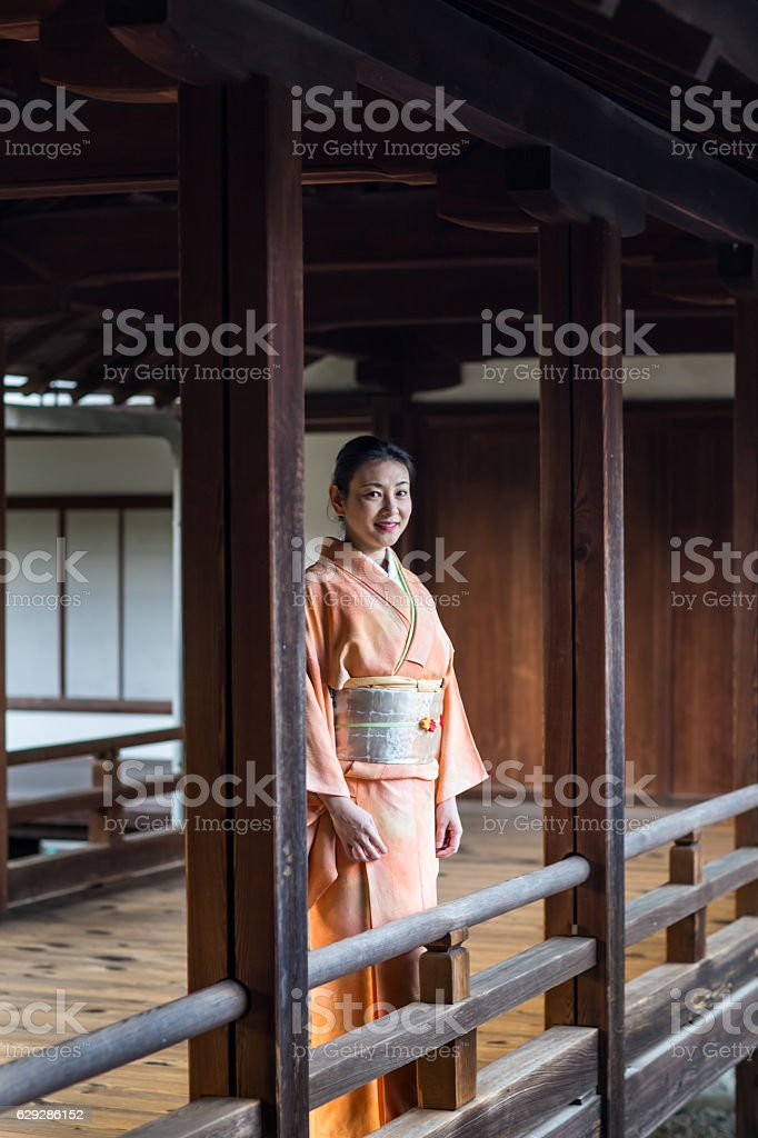 Woman in kimono at a Japanese temple stock photo