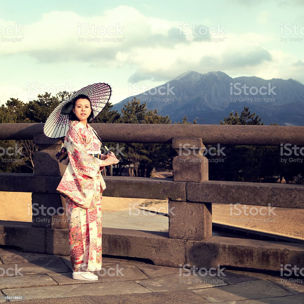 Woman in kimono with umbrella stock photo