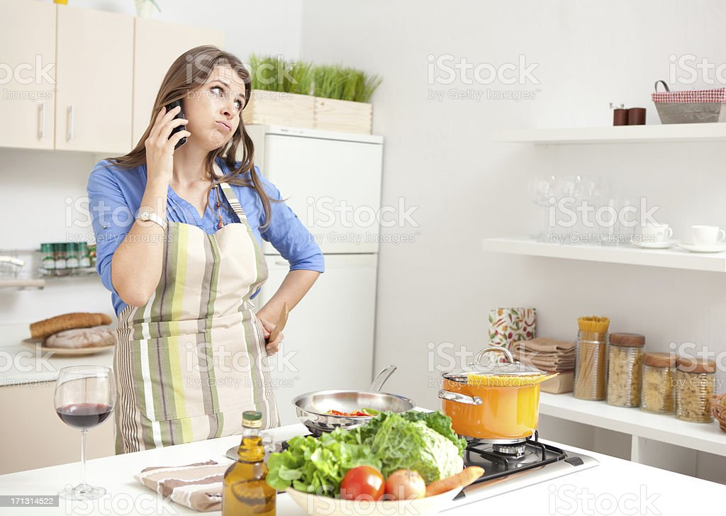 Woman in kitchen. stock photo