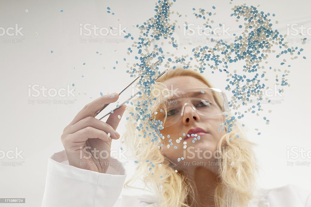 Woman in lab coat selecting Muisjes stock photo
