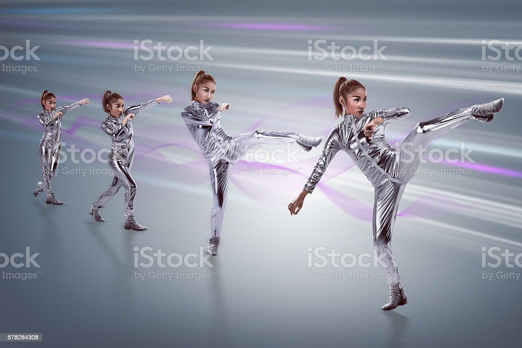 Woman in latex suit with fight stance stock photo